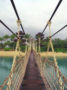 Suspended bridge to Sentosa Island, Singapore (by jiridracek).