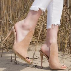 A mule-inspired topline heightens the modern sophistication of this alluring stiletto sandal