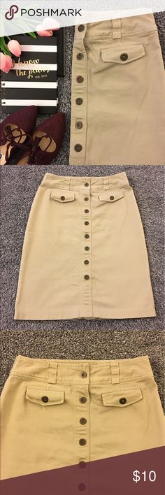 Tan, button front skirt - loved Cute tan skirt with button front and pocket detail. Most of the front (within reason for getting on) and the back split have been sown up. Pre loved with some darker spots on the back. They really are not very noticeable and did not stop me from wearing but see pics for details and condition. Loved with life left and smoke free item. Waist is 16 inches flat. Hips are 19. Length is 25. Have questions? Ask me! Offers and bundles welcome but please no models or…