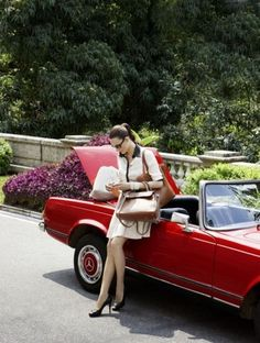 Red Mercedes Benz and girl