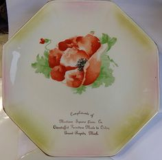 About 1920 on this hand-painted advertising plate.