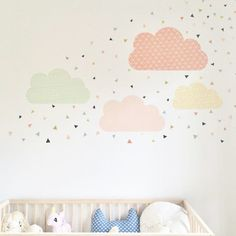 so sweet and happy!  Our geometric clouds and fun tiny confetti triangles in this fresh and colorful nursery!