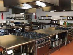 Interesting layout with island cooktops and separate hoods in several group clusters. Commercial Kitchen Design