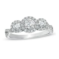 Brides.com: Three-Stone Engagement Rings. Style 19008911, 1 ct. t.w. diamond three-stone past, present, future ring in 14k white gold, $1,999.99, Zales                                                                                                               See more Zales engagement rings.