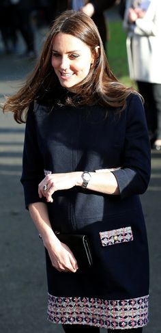 Kate Middleton styled her engagement ring with her navy and black ensemble.