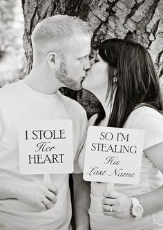 "Save the date photo idea- couple kissing holding up signs ""I stole her heart"" ""So I'm stealing his last name"""