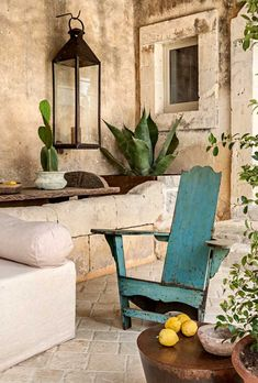 Rustic European styled outdoor seating with washed out turquoise chair. Outdoor Rooms, Outdoor Living, Outdoor Decor, Outdoor Seating, Patio Interior, Interior Design, Stone Houses, Mediterranean Style, Spanish Style