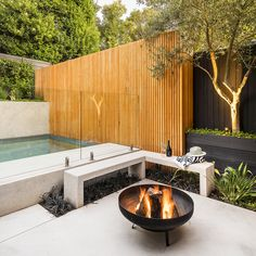 This suburban backyard has been transformed into the entertaining hub of the home. Bringing to life a clean, modern design, the garden is now a spacious family-friendly space, with a huge wow factor! Modern Backyard Design, Pool Landscape Design, Small Backyard Design, Backyard Pool Designs, Small Backyard Patio, Backyard Garden Design, Garden Pool, Backyard Ideas, Outdoor Pool