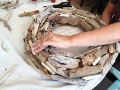 Continue adding driftwood until the entire wreath form is covered.