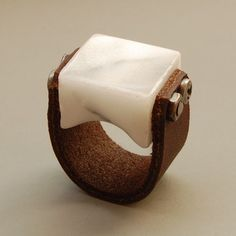 Ring | Blind Spot Jewellery Designs.  Carved Carrara marble and leather.