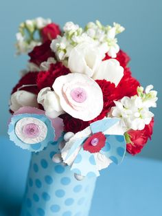 like the handmade flowers and the paper-wrapped vase...
