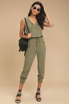 98bf13d0dc75 You ll be ready for anything with the Olive   Oak Scarlett Olive Green  Jumpsuit! Soft and lightweight woven rayon sweeps over a sleeveless bodice  (with ...