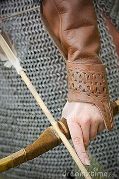Medieval hunter warrior with a bow and arrow