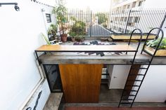 Set on the rooftop of a building in city São Paulo, Brasil, this tiny property is used as a guest house for visitors. The house replaces an existing struct Craftsman Interior, Interior Exterior, Exterior Design, Siding Colors For Houses, Exterior Siding Colors, Lofts, Patio Roof, Paint Colors For Home, Small Patio