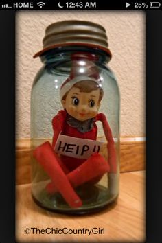 Elf on the shelf - trapped in jar, maybe stealing cookies/candy