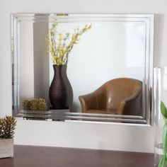 Houston Frameless Wall Mirror by Decor Wonderland. $139.99. Double coated silver backing with seamed edges. Ready to hang vertically or horizontally. Unique design with v-grooved cut and tri beveled designs. Wipe clean with damp cloth. Includes mounting hardware. Frameless Houston wall mirror is a rectangular contemporary accent piece with self edging that features a triple bevel for bathrooms. Includes mounting hardware. Unique design with v-grooved cut and tri beveled designs. ...