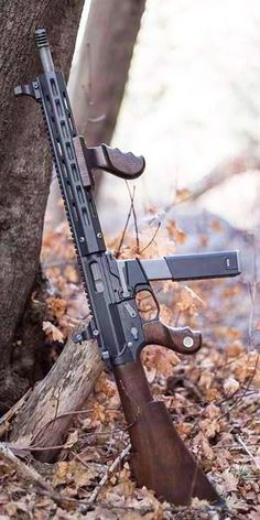 Wacky wood! Wood furniture to make this 9mm AR look like a tommy gun. Somehow I'm not as disgusted as I think I should be Assault Rifle, Fogo, Airsoft, Hand Guns, Shotguns, Firearms, Custom Guns, Custom Ar, Arsenal