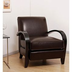 Living room furniture has hardwood frame constructionChair is covered with leatherFurniture has dark walnut color legs and arms