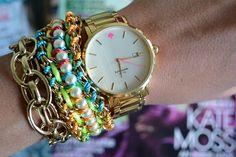 gold watch & neon bracelets.