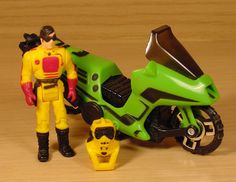 "The Condor motorcycle / helicopter, along with driver / action figure Brad Turner and the ""Hocus Pocus"" mask, from the M.A.S.K. series of toys"
