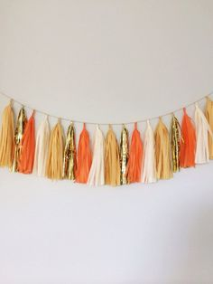 Our new orange, ivory and gold tassel garland banner will add the perfect amount of glitz and glam to your fall and thanksgiving decor!    We see