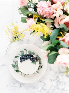 Blueberry topped cake: http://www.stylemepretty.com/living/2016/05/02/the-prettiest-ever-mothers-day-bar-cart-blueberry-rose-cocktail/ | Photography: Divya Pande - http://divyapande.com/life/