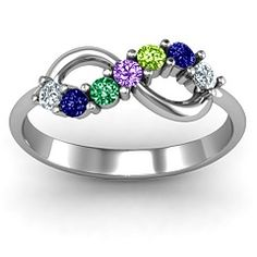 This is the ring I was talking about except the one I saw only had three stones in the middle instead of 7. @Leah Bailey