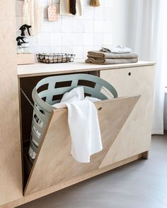 Simple laundry hamper built-in. Love the 'handles' too