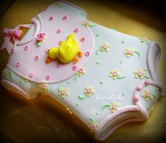 Adorable baby onesie cake.