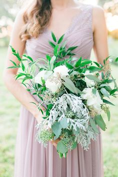 Greenery bridesmaid bouquet idea - overflowing bouquet with greenery and white flowers {Photo by @Theleesphoto}
