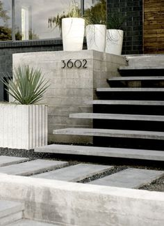 modern cantilever steps, pavers, gravel & planters