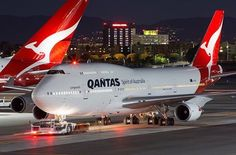 Qantas Boeing 747-438/ER night ops at LAX (the tail of a company Airbus A380-842 is visible in the background)