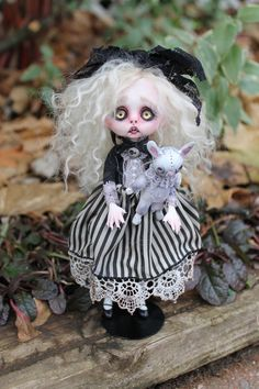 Alice Awakened.  She is a goth Alice in wonderland posable soft body doll.  Her head, hands, and feet are made of polymer clay.