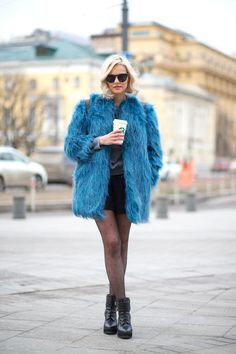 A coffee can only keep you so warm when it's cold - wrap yourself up in a fur coat for guaranteed coziness.