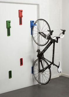 17 Amazing Bike Storage Ideas You Just Have To See Amazing space-saving bike helmet storage ideas for small room and apartments. These indoor bike storage solutions are for pedal pushers who can't part with their bike. Hanging Bike Rack, Indoor Bike Rack, Indoor Bike Storage, Diy Bike Rack, Home Bike Rack, Bike Hanger Wall, Bike Stand Diy, Bicycle Hanger, Bicycle Stand