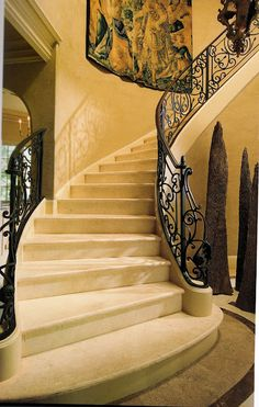 French style marble staircase with beautiful iron railing, with French style newel detail.