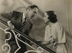 """Olivia de Havilland and Leslie Howard in a scene from """"It's Love I'm After"""" 1937"""