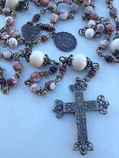 handcraft heirloom quality gemstone rosaries in classical chain work.  The rosary bead parts are vintage reproduction.