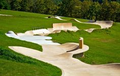 This skate park looks like a greenway. What a great use of the topography!