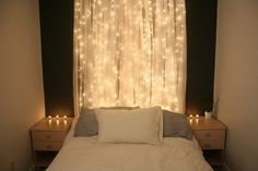 Xmas lights and sheer curtains as a headboard. Whatever, I'm a sucker for xmas lights. I'm SO doing this with my plum sheer curtains.