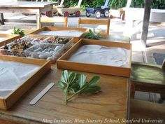 Individual sand trays and beautiful natural materials at Bing Nursery School