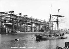 Titanic being prepared for her launch, scheduled to take place on 31 May 1911.  This wonderful photograph shows the enormous scale of Titanic's steel hull as it sits on Slipway No. 3, within the enfolding structure of the great Arrol Gantry.  The image also captures a poignant moment, as the old maritime technology of the traditional wooden schooner in the foreground, gradually gave way to the machine-age modernity of Titanic.
