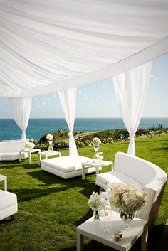 outdoor sofa wedding idea with soft white drapes and white couches. This this would only work in the Sun not Ireland. LMC
