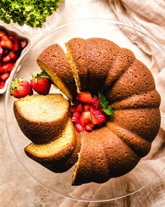 There's nothing quite like an impressive looking, yet super easy cake to usher in the warmer weather of Spring. This Brown Sugar Bundt Cake is flavorful, moist and comes together quickly. Top with the season's best - fresh strawberries macerated in a bit of powdered sugar. Simple and delicious! Homemade Desserts, Dessert Recipes, Cake Recipes, Bacardi Rum Cake, Banana Pudding Trifle, Brown Sugar Cakes, Spring Cake, Deserts, Desert Recipes