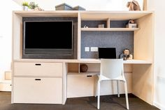 This desk and media unit offers storage in the form of deep drawers as well as a secret feature underneath