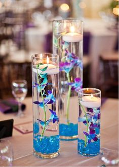 blue and purple wedding centerpieces | Centerpiece Options - Light Blue/Purple Wedding.  I LIKE THE IDEA BUT WITH DIFFERENT COLORED BOUQUETS OF ORCHIDS AND MATCHING STONES, SEVERAL PER TABLE
