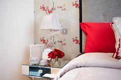 Opulent master bedroom suite detail with velvet head board.