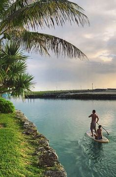 Paddleboarding down the canal where many of our private villas are located! West End, Grand Bahama Island, The Bahamas