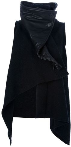 ANN DEMEULEMEESTER, SIBIL ASYMMETRIC JACKET: wool and detachable leather funnel neck.