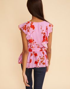 Back view of the poppy printed silk ruffle top.